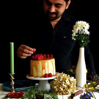 Vanilla Raspberry Cake - Pepper Delight #pepperdelightblog #recipe #cake #vanillacake #raspberry #birthdaycake #celebration #christmas #dessert #birthday #buttercream #party #holidayrecipes #holidaycake #seminakedcake #nakedcake #caramel
