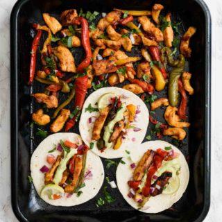 Sheet Pan Chicken Fajitas- Pepper Delight #pepperdelightblog #recipe #fajita #healthy #mexican #sheetpan #mealprep #cleaneating #dinner #onepandinner #sheetpanfajita #onepanchicken #roastedchicken #sheetpanchicken #makeaheadrecipes