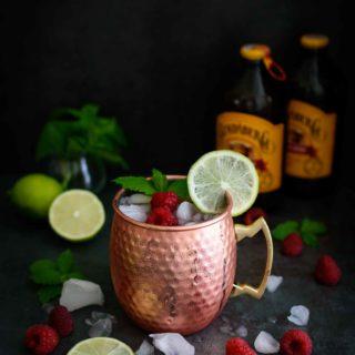 Raspberry Moscow Mule- Pepper Delight #pepperdelightblog #recipe #moscowmule #raspberrymoscowmule #cocktail #drinks #summerdrinks #winterdrinks #holidaycocktails #raspberrydrinks #gingerbeer