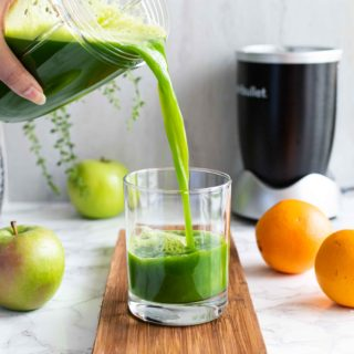 Healthy Green Juice made with Kale, Celery, Apples and Oranges